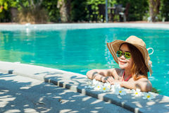 Young woman with style To relax. At the swimming pool in summer Stock Image