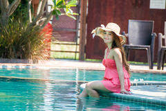 Young woman with style To relax. At the swimming pool in summer Royalty Free Stock Images