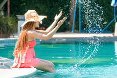 Young woman with style To relax. At the swimming pool in summer Royalty Free Stock Photos