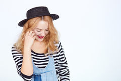 Young woman in stylish hat and denim with eyes closed Royalty Free Stock Photos