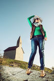 Young woman with stylish hat and an old romanesque church Archan Stock Photography