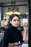 Young woman in a stylish old European cafe Stock Photography