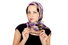 Young woman in a stylish scarf in a cage Royalty Free Stock Photos