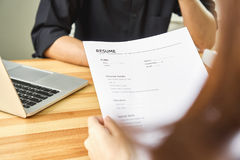 Young woman submit resume to employer to review job application. The concept presents the ability for the company to agree. With the position of the job Royalty Free Stock Photos