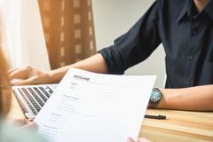 Young woman submit resume to employer to review job application. The concept presents the ability for the company to agree with the position of the job Royalty Free Stock Images