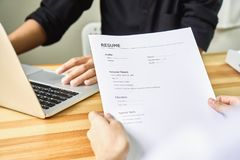 Young woman submit resume to employer to review job application. The concept presents the ability for the company to agree with the position of the job Stock Photos