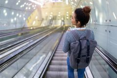 Young woman on subway escalator Royalty Free Stock Image
