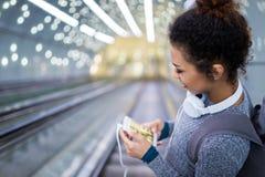 Young woman on subway escalator Stock Image