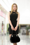 Young woman with suede bag, close up Royalty Free Stock Image
