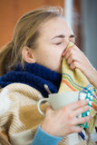 Young woman suffering of cold and having stuffy nose Stock Image