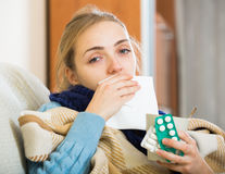 Young woman suffering of cold and having stuffy nose Stock Photos