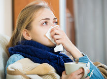 Young woman suffering of cold and having stuffy nose Royalty Free Stock Photos
