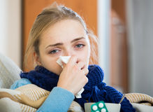 Young woman suffering of cold and having stuffy nose Stock Photography
