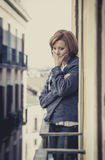Young woman suffering depression and stress outdoors at the balcony Stock Images