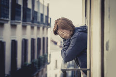 Young woman suffering depression and stress outdoors at the balcony Royalty Free Stock Photography