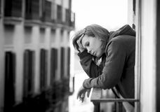 Young woman suffering depression and stress outdoors at the balcony Royalty Free Stock Image