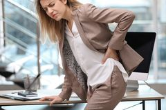 Free Young Woman Suffering From Back Pain Royalty Free Stock Photos - 138888728
