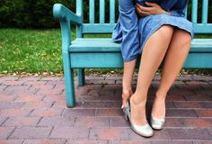 Free Young Woman Suffering From Pain In Legs Because Of Uncomfortable Shoes Outdoors Stock Photo - 151162560