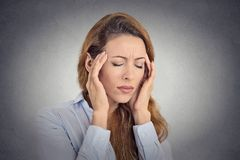 Young woman suffering, having headache royalty free stock image