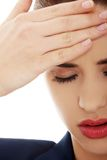 Young woman suffering a headache Stock Photography