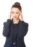 Young woman suffering a headache Stock Photos