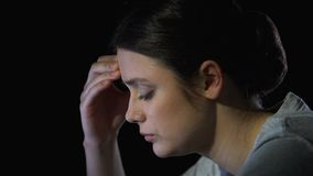 Young woman suffering headache, feeling depression and exhaustion, closeup stock video