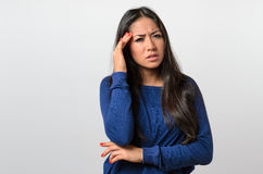 Young woman suffering from a headache Stock Image
