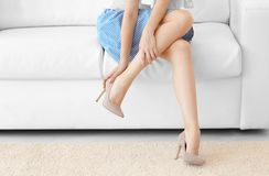 Young woman suffering from leg pain. At home stock images