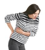 Young woman suffering from pain. On white background Royalty Free Stock Image