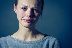Young woman suffering from severe depression/anxiety/sadness. Crying, tears coming from her eyes royalty free stock photos