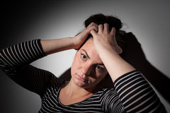 Young woman suffering from a severe depression Stock Images