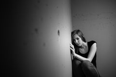 Young woman suffering from a severe depression Royalty Free Stock Image