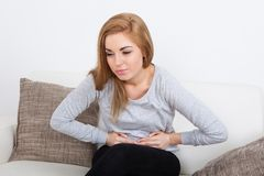 Young woman suffering from stomach ache Royalty Free Stock Image
