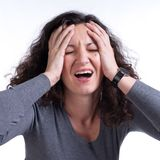 Young woman suffering from a terrible headache Royalty Free Stock Image
