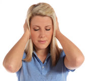 Young woman suffering from tinnitus Royalty Free Stock Images