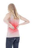 Young woman suffers from back pain Royalty Free Stock Photos