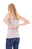 Young woman suffers from back pain Stock Images