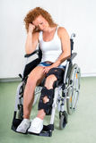 Young woman suffers from knee injury Stock Photos