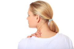 Young woman suffers from neck pain Royalty Free Stock Photography