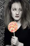 Young woman with a sugar candy Stock Photos