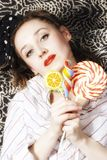 Young woman with a sugar candy Royalty Free Stock Photo