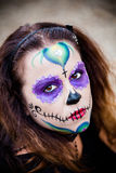 Young woman with sugar skull makeup Royalty Free Stock Image