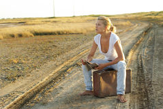 Young woman with a suitcase Royalty Free Stock Image
