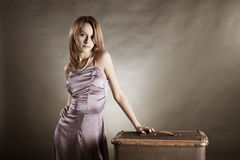 Young woman with a suitcase Stock Photography