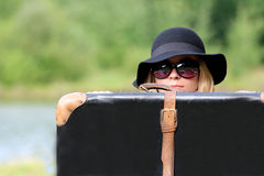 Woman with a suitcase Stock Photos