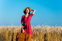 Young woman with suitcase and camera Stock Photography