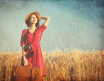 Young woman with suitcase and camera Stock Photos