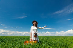 Young woman with suitcase and camera Royalty Free Stock Image