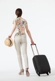 Young woman  with suitcase going away Stock Photo