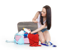 Young woman with suitcase. Royalty Free Stock Photo